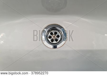 Chrome Drain Hole In Sink. Fresh And Clean White Sink And Silver Water Filter. Drain In A White Clea