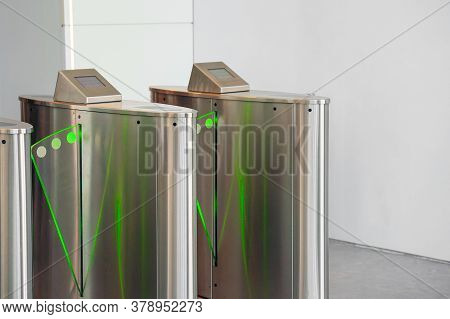 Automatic Security Turnstiles With Card Reader In A Corporate Office Building. Automatic Security Ga