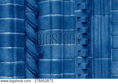 Brick Work Wall With Ornament On Old Building. Dark Blue Brick Wall Texture Architecture Background.