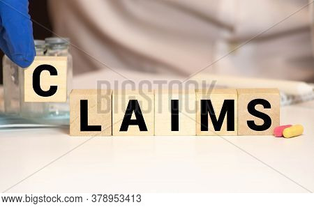 Claims Word Written On Wood Block. Claims Text On Wooden Table For Your Desing, Concept.