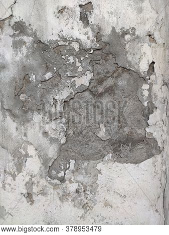 Grey Concrete Texture Old Wall With Peeling Paint, Scratches And Cracks