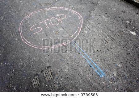 Stop sign made by kids by chalk on asphalt poster