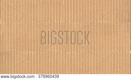 Corrugated cardboard texture. Blank empty cardboard with ridges and folded creases. Recycled material background.
