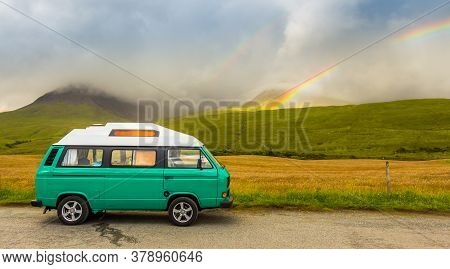 Isle Of Skye, Scotland - July 14th 2016: An Old Green Camper Van In The Shadow Of The Misty Cuillin
