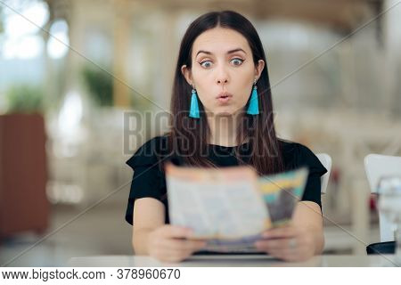 Funny Surprised Girl Reading A Tabloid Newspaper