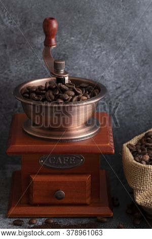 Coffee Beans And A Brown Wooden Grinder
