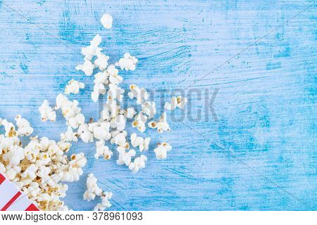 Pop Corn On Blue Background And With Copy Space