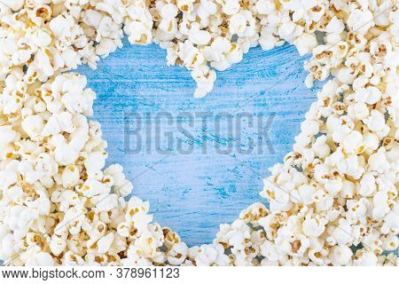 Pop Corn In The Shape Of Heart On Blue Background And With Copy Space