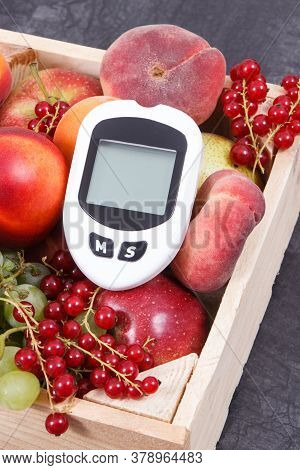 Glucometer Foe Measuring Sugar Level And Fresh Fruits In Wooden Box As Healthy Snack Or Dessert Cont
