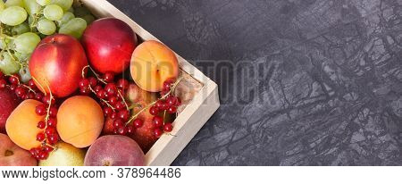 Heap Of Fresh Fruits In Wooden Box As Healthy Snack Or Dessert Containing Natural Vitamins And Miner