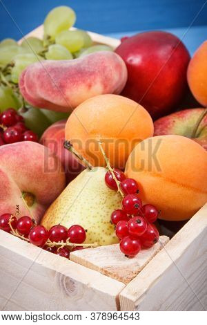 Heap Of Fresh Natural Fruits In Wooden Box. Nutritious Food Containing Healthy Minerals And Vitamins