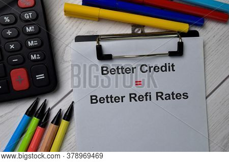 Better Credit Equal Better Refi Rates Text Write On Paperwork Isolated On Office Desk.