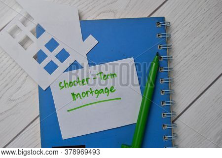 Shorter-term Mortgage Text Write On Sticky Notes Isolated On Office Desk.