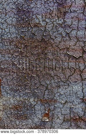 Creative Old Abstract Background Of Large Cracks Of Old Weathered Paint On The Wall. Old Paint Weath