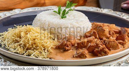 Chicken Stroganoff With Rice And Potato Straw.
