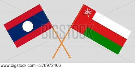 Crossed Flags Of Oman And Laos. Official Colors. Correct Proportion. Vector Illustration