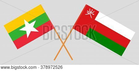 Crossed Flags Of Oman And Myanmar. Official Colors. Correct Proportion. Vector Illustration