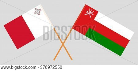 Crossed Flags Of Oman And Malta. Official Colors. Correct Proportion. Vector Illustration
