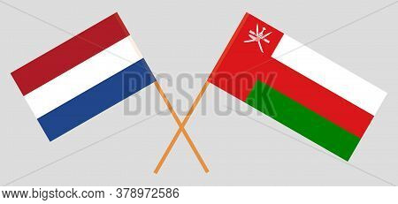 Crossed Flags Of Oman And Netherlands. Official Colors. Correct Proportion. Vector Illustration