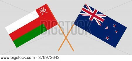Crossed Flags Of Oman And New Zealand. Official Colors. Correct Proportion. Vector Illustration