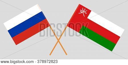 Crossed Flags Of Oman And Russia. Official Colors. Correct Proportion. Vector Illustration