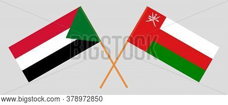 Crossed Flags Of Oman And Sudan. Official Colors. Correct Proportion. Vector Illustration