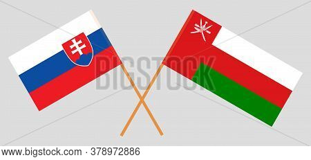 Crossed Flags Of Oman And Slovakia. Official Colors. Correct Proportion. Vector Illustration