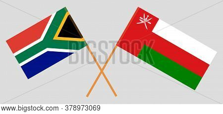 Crossed Flags Of Oman And The Rsa. Official Colors. Correct Proportion. Vector Illustration