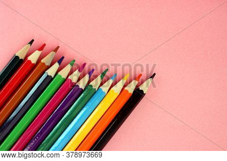 Colored Pencils On A Pink Background. Lots Of Different Colored Pencils. Colorful Pencil. Pencils Ar