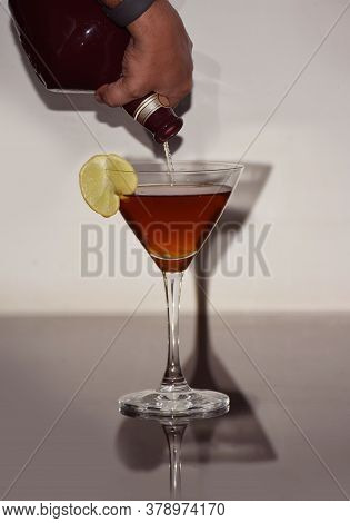 A Person Pouring Finest Aged Whiskey In A Glass.
