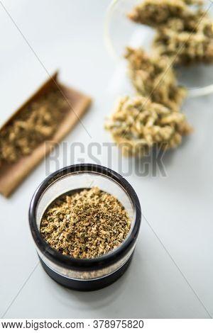 White Background. Marijuana Nature Bud. The Pot Leaves On Buds Thc Cbd. Grinder And Cannabis Weed Bu