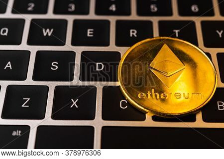 Golden Ether Coins Or Ethereum Network Exchange On Keyboard Of Laptop Computer, Electronic Money Wor