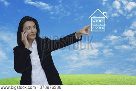 Caucasian Businesswoman Pressing Work From Home Flat Icon Over Green Grass Field With Blue Sky, Busi