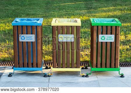 Recycling Bins Of Different Colors (yellow, Green, Blue) Outdoors. Garbage Bin In The Park, Trash Ca
