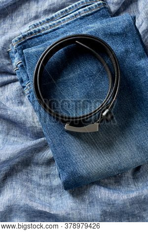 Jeans Trousers On Blue Background. Top View. Copy Space.