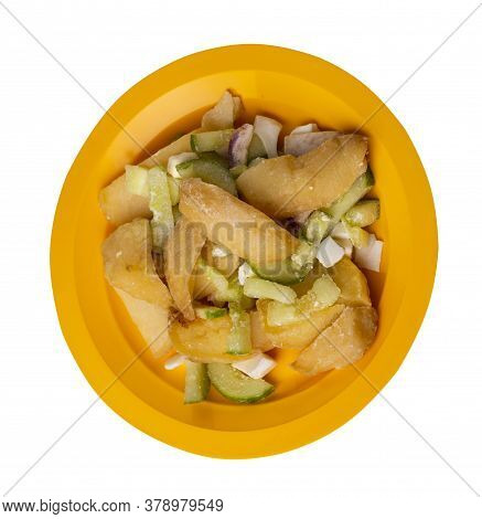 Potato Wedges With Vegetables On Yellow Plate Isolated On White Background. Junk Food . Rustic Food.