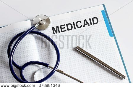 Paper With Text Medicaid On A Table With Stethoscope