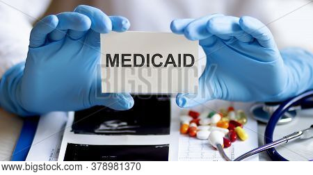 Text Medicaid Write On A Medicine Card. Medical Concept With A Stethoscope And Pills