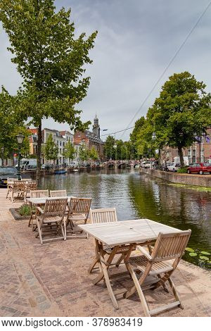 Leiden, Netherlands - July 22, 2020: Cityscape Leiden View Rapenburg With Academy Building Of The Un