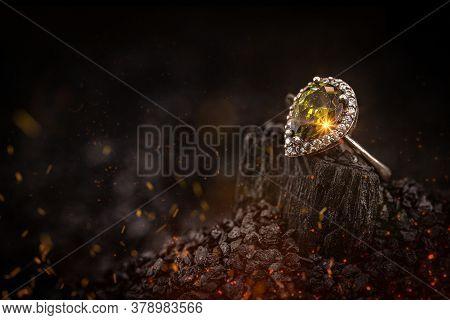 Silver Jewelry With Yellow Stone On Dark Background