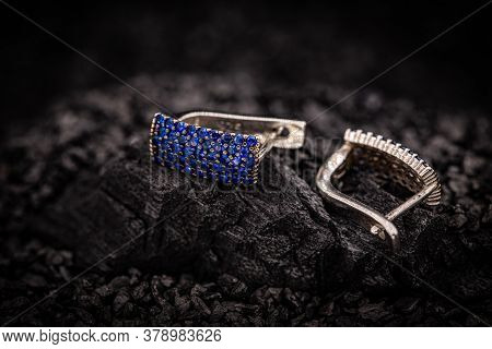 Pair Of Earrings With Small Blue Stones On Coal Background