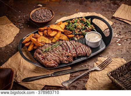 Juicy Steak Medium Rare Beef With Green Salad And Fried Potatoes