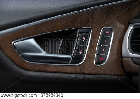 Novosibirsk/ Russia - July 27 2020: Audi A7, Close-up Of The Side Door Buttons: Window Adjustment Bu