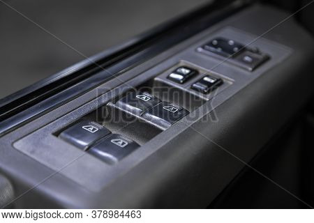Novosibirsk/ Russia - July 27 2020: Infiniti Qx56, Close-up Of The Side Door Buttons: Window Adjustm