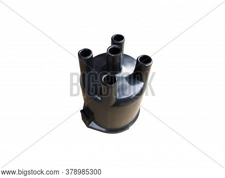 New Car Ignition Distributor Cap On An Isolated White Background. Spare Parts.