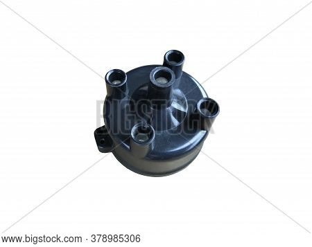 Car Ignition Distributor Cap On An Isolated White Background. New Spare Parts.