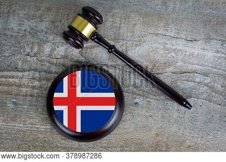 Wooden Judgement Or Auction Mallet With Of Iceland Flag. Conceptual Image.
