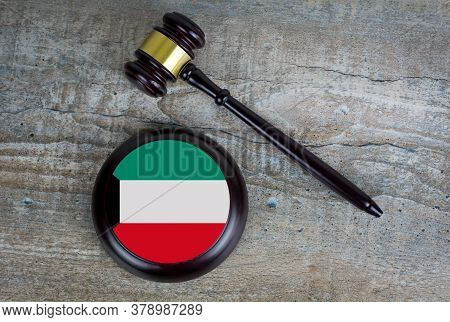 Wooden Judgement Or Auction Mallet With Of Kuwait Flag. Conceptual Image.