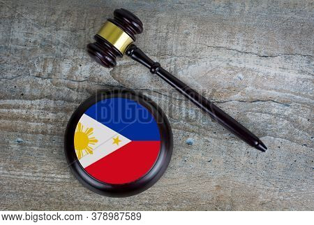 Wooden Judgement Or Auction Mallet With Of Philippines Flag. Conceptual Image.