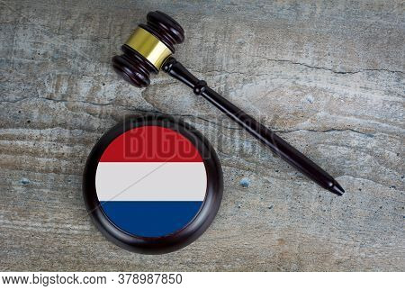 Wooden Judgement Or Auction Mallet With Of Netherlands Flag. Conceptual Image.